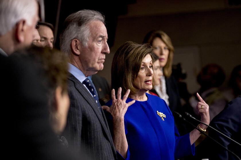 House Speaker Nancy Pelosi of Calif., accompanied by Chairman of the House Ways and Means Committee Richard Neal, D-Mass., left, and other House members, speaks at a news conference to discuss the United States Mexico Canada Agreement (USMCA) trade agreement, Tuesday, Dec. 10, 2019, on Capitol Hill in Washington. (AP Photo/Andrew Harnik)