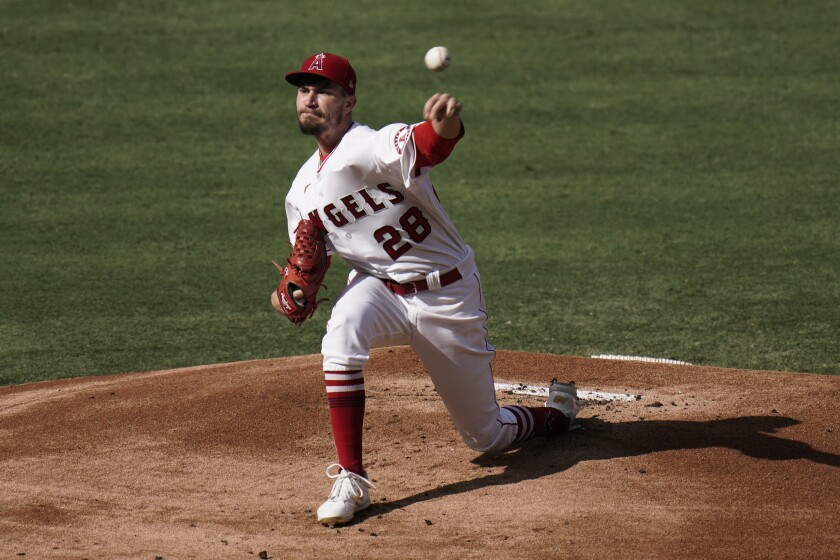 Los Angeles Angels starting pitcher Andrew Heaney throws against the San Diego Padres during the first inning of a baseball game, Thursday, Sept. 3, 2020, in Anaheim, Calif. (AP Photo/Jae C. Hong)