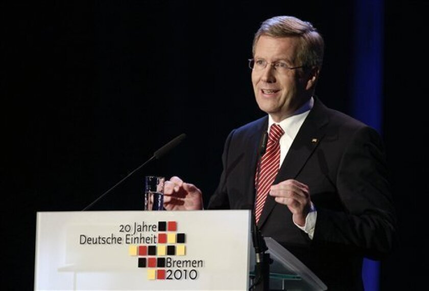 """German President Christian Wulff speaks during celebrations marking the 20th anniversary of the country's reunification, in Bremen, northern Germany, Sunday Oct. 3, 2010. Germany's post-World War II division ended on Oct. 3, 1990, less than 11 months after communist East Germany opened the Berlin Wall amid pressure from massive protests. President Christian Wulff said at the main anniversary event Sunday that reunited Germany has developed """"an uninhibited patriotism, an open commitment to our country."""" (AP Photo/dapd/Axel Heimken)"""