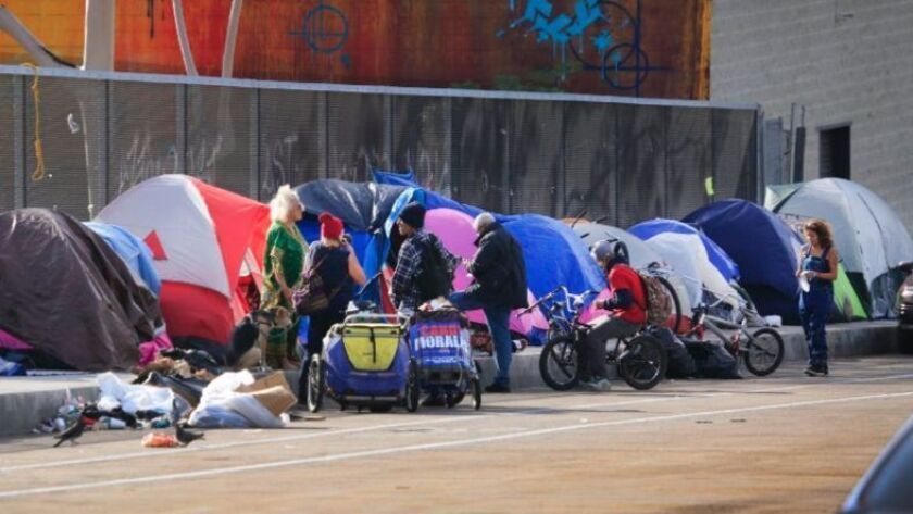 Tents of homeless people line the Island Avenue overpass.
