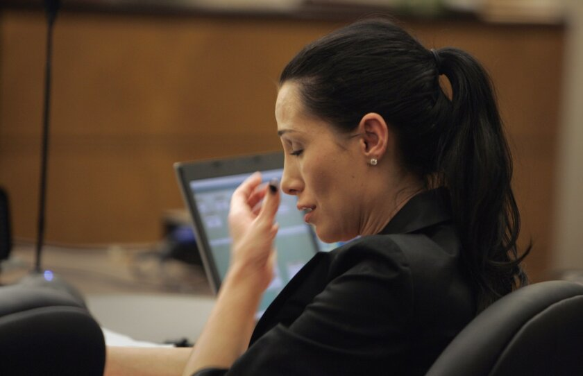 Cheri Olvera reacts in court on March 24.