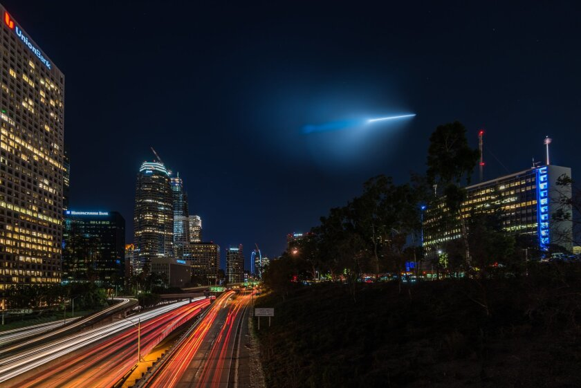 A Trident missile the Navy tested off Los Angeles Saturday night is shown from the Fourth Street bridge over 110 Freeway in Los Angeles. Photographer Preston Newman was on a photo shoot at the time.