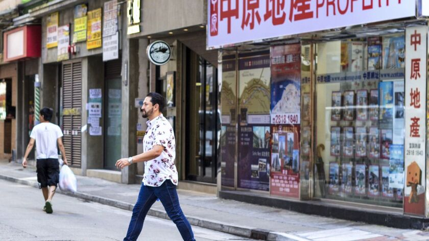 Chef Esdras Ochoa walking the streets in Hong Kong, where he is opening a new restaurant in August.