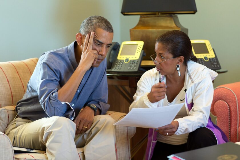 President Obama, left, meets with National Security Advisor Susan E. Rice following foreign leader phone calls, from Chilmark, Mass. Obama said the naming of a new prime minister in Baghdad is a promising step forward in the effort to form a unifying Iraqi government.