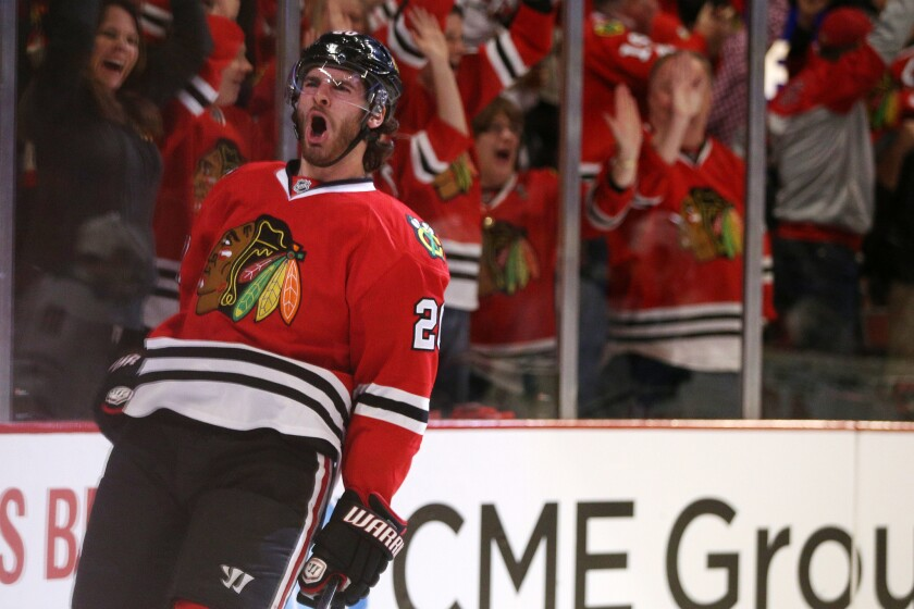 Brandon Saad celebrates after scoring against the Minnesota Wild at the United Center.
