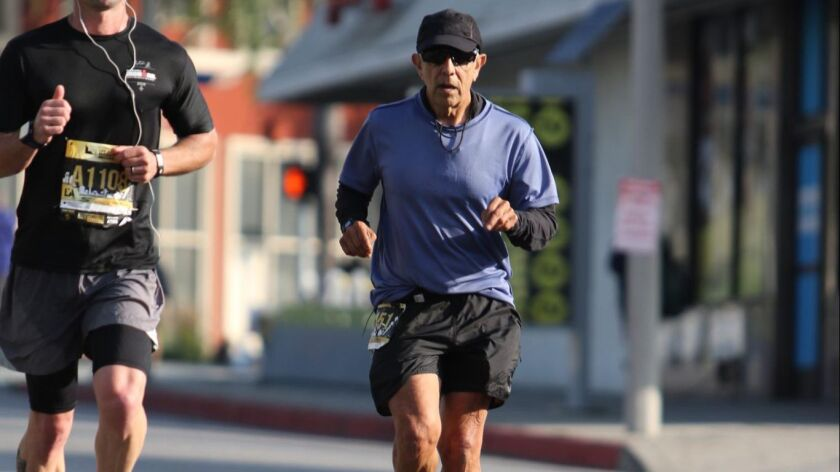 Frank Meza (right) is seen running in the Sketchers Los Angeles Marathon Photo by FinisherPix