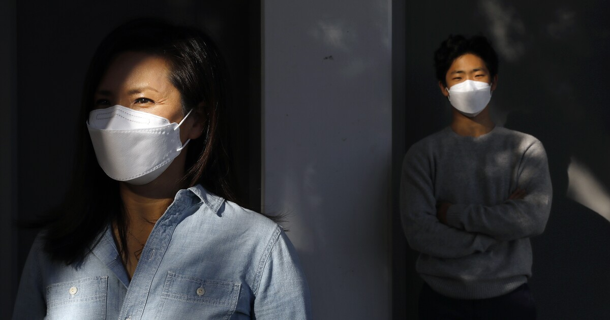 www.latimes.com: Some Asian Americans and immigrants wore masks readily. In a brutal election year, it made them heroes, targets, prophets