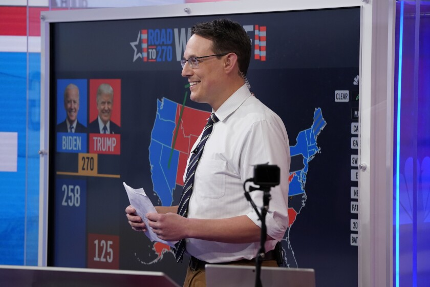 Steve Kornacki standing in front of his MSNBC election map