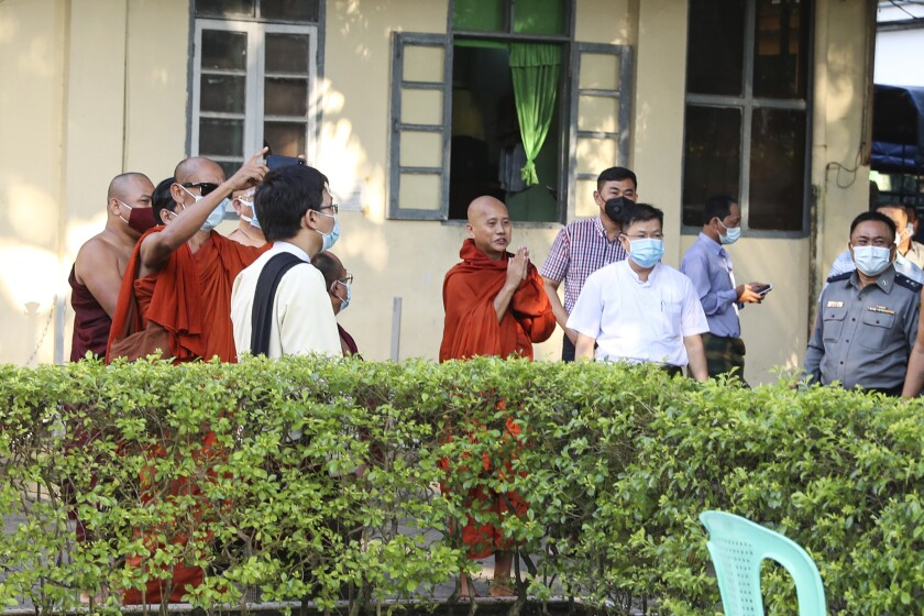 Buddhist monk Ashin Wirathu gestures to his followers at a police station in Yangon, Myanmar.