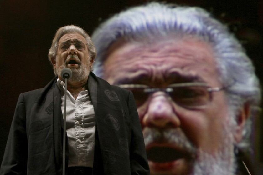 "FILE - In this Dec. 19, 2009 file photo, Placido Domingo performs during a sound check prior to a free concert in Mexico City. Domingo's name has been removed from the Washington National Opera's young artist program ""in light of recent developments,"" the opera house announced Tuesday, March 3, 2020. (AP Photo/Marco Ugarte, File)"