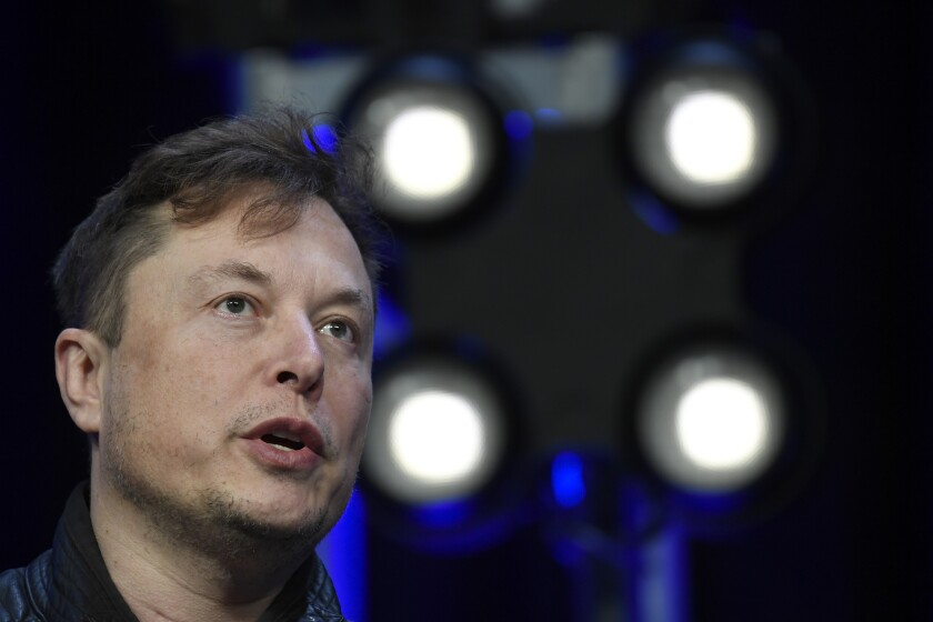 FILE - In this March 9, 2020, file photo, Tesla and SpaceX Chief Executive Officer Elon Musk speaks at the SATELLITE Conference and Exhibition in Washington. Electric car maker Tesla will stop accepting Bitcoin as a payment, CEO Elon Musk tweeted on Wednesday, May 12, 2021 citing environmental concerns. (AP Photo/Susan Walsh, File)