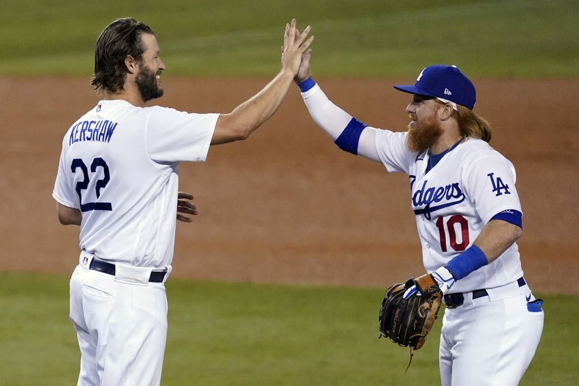 Clayton Kershaw and Justin Turner celebrate the Dodgers' victory Thursday.