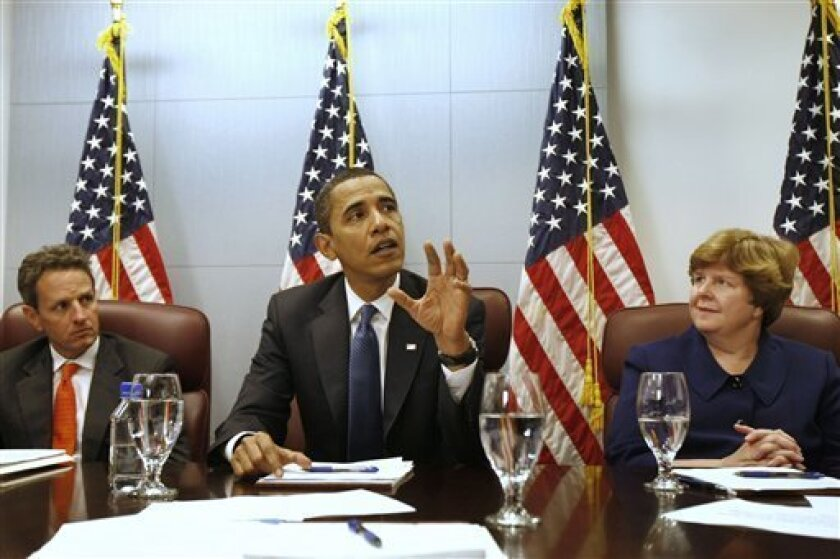 In this Jan. 5, 2009 file photo, then-President-elect Barack Obama, flanked by then-Treasury Secretary-designate Timothy Geithner, left, and then-Council of Economic Advisers Chair-designate Christina Romer, meets with members of his economic team at his transition office in Washington. A report released earlier this month by Christina Romer, chairman of the White House Council of Economic Advisers, and Jared Bernstein, an economic policy adviser to Vice President Joe Biden, predicted that more than 90 percent of the 3 million to 4 million jobs Obama's proposed stimulus proposes to save or create would be in the private sector. But the report also estimated that 244,000 government jobs - some at the federal level, but more at the state and local level - would be created or saved. That was based on a $600 billion stimulus package; the one being debated in Congress is more than $800 billion. (AP Photo/Gerald Herbert, File)