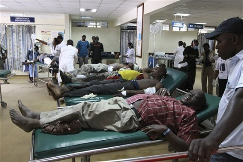 Victims from a blast receive medical attention at the Kenyatta hospital in Nairobi ,Kenya, Sunday, June, 5, 2011. An explosion in a highly populated area of downtown Nairobi on Sunday injured at least 29 people, and officials said an investigation is under way to determine if the blast was caused by terrorism.(AP Photo/Khalil Senosi)