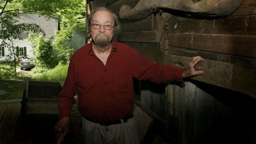 Donald Hall poses in the barn of the 200-year-old Wilmot farm that has been in his family for four generations on June 13, 2006.