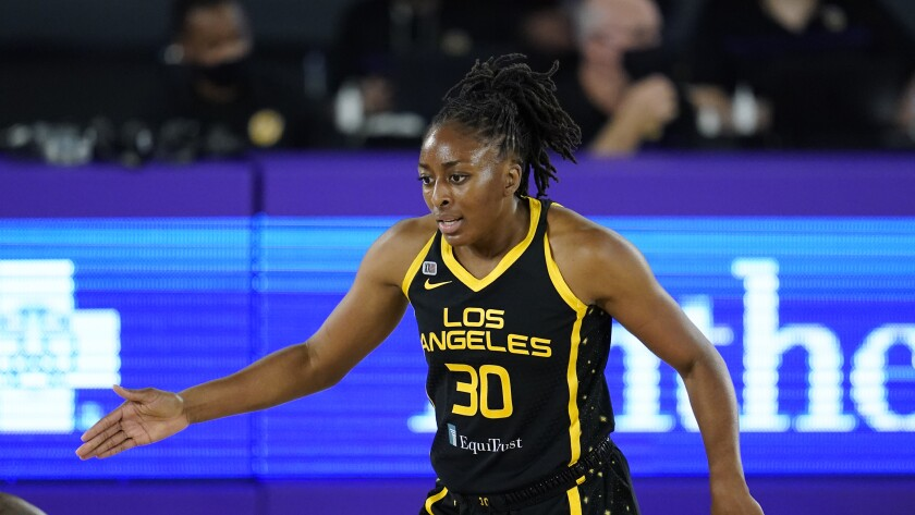 Sparks forward Nneka Ogwumike (30) talks to her teammates during a WNBA basketball game.