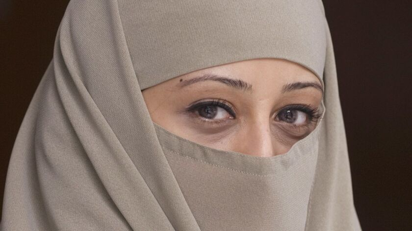 A woman wears a niqab in Montreal.