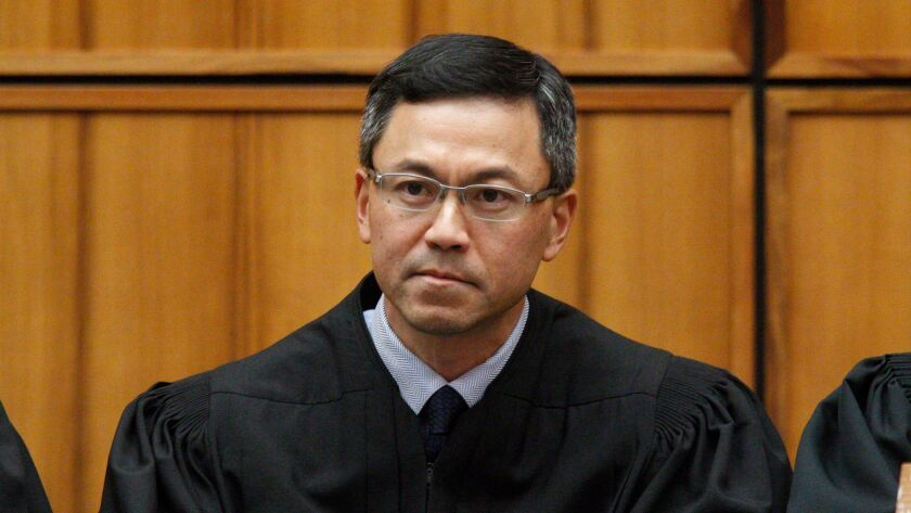 FILE - This Dec. 2015 file photo shows U.S. District Judge Derrick Watson in Honolulu. Hawaii's Demo