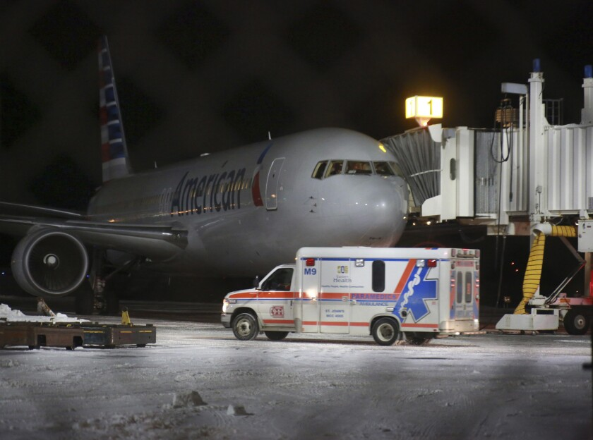 An ambulance leaves St. John's International Airport on Sunday in St. John's, Newfoundland. Several people were taken to a hospital after an American Airlines plane from Miami to Milan made an emergency landing after the jet briefly encountered severe turbulence.