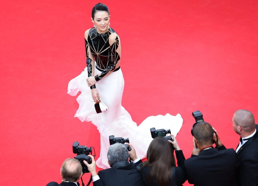 """Chinese actress Zhang Ziyi wears a Stephane Rolland Couture gown as she arrives for the screening of """"Grace of Monaco"""" and the opening ceremony of the 67th annual Cannes Film Festival in Cannes, France."""