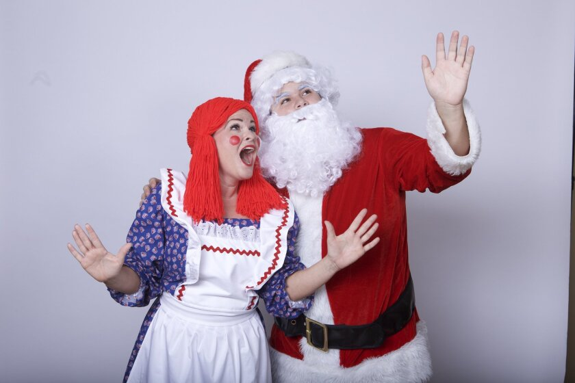 Beverly Baker and Nicolas Scutti in 'The Christmas Toyshop' at North Coast Repertory Theatre in Solana Beach.