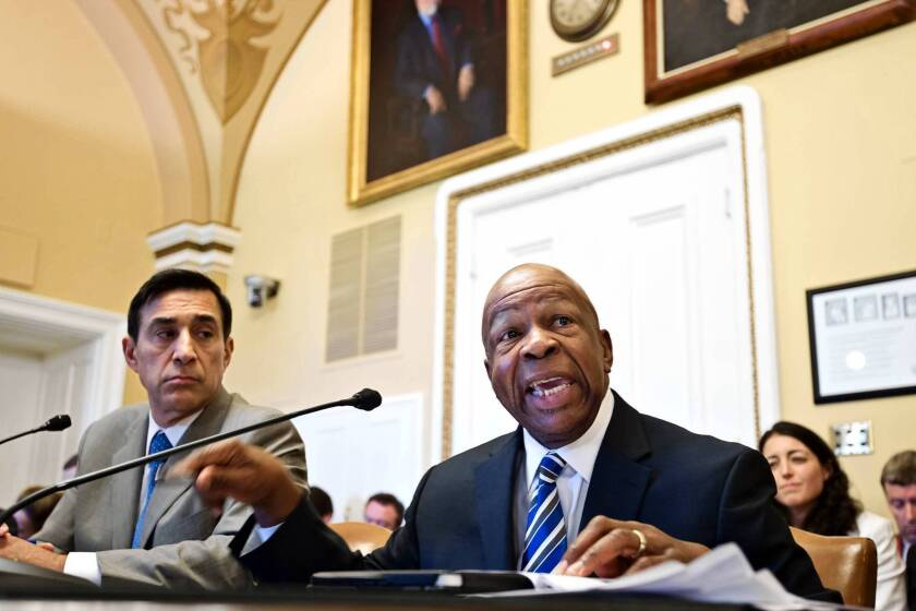 Chairman Darrell Issa (R-Vista), left, and Rep. Elijah E. Cummings (D-Md.) of the House Oversight and Government Reform Committee argue procedures before the House Rules Committee for Thursday's contempt of Congress vote on Atty. Gen. Eric H. Holder Jr.