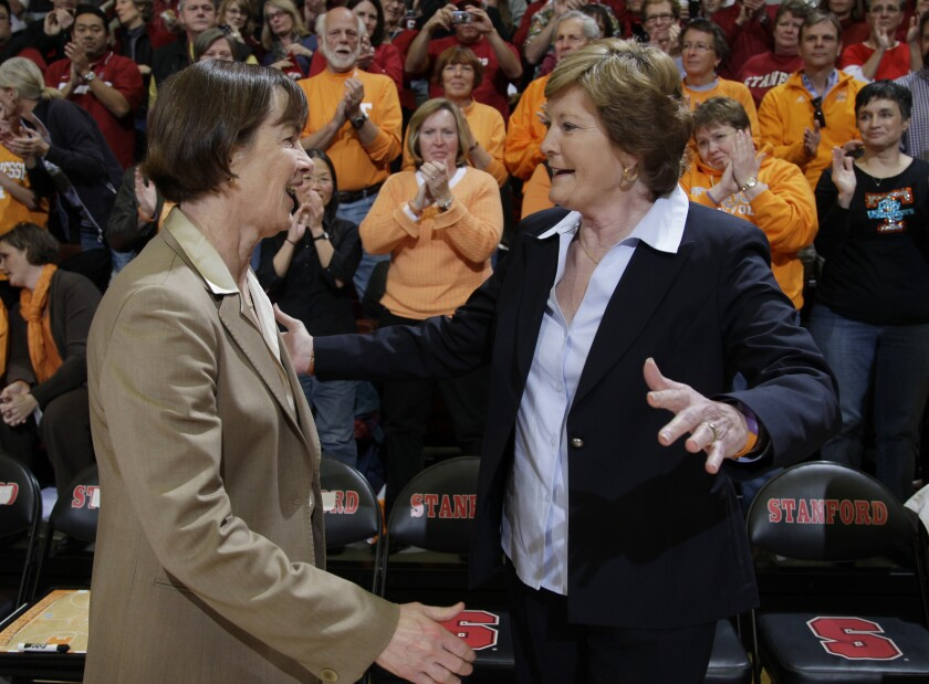 FILE - Stanford head coach Tara VanDerveer, left, and Tennessee head coach Pat Summitt, right, and greet each other before an NCAA college basketball game in Stanford, Calif., in this Tuesday, Dec. 20, 2011, file photo. Their mutual respect always showed, and shined. So, when VanDerveer tied the late Hall of Famer as winningest women's coaches in history with 1,098 victories Sunday night, Dec. 13, 2020, she quickly credited Summitt for helping her get there. (AP Photo/Paul Sakuma, File)