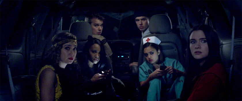 """Schuyler Helford, from left, Lauryn Alisa McClain, Andrew Caldwell, Will Brittain, Shazi Raja and Katie Stevens in """"Haunt."""""""