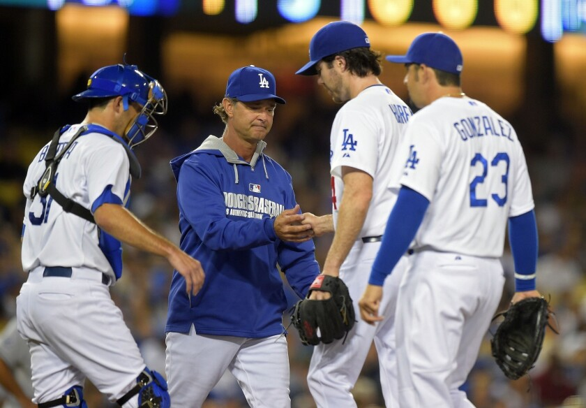 Dodgers Manager Don Mattingly takes Dan Haren out of the game in the fifth inning. Haren (8-6) was charged with four runs on six hits over four innings.