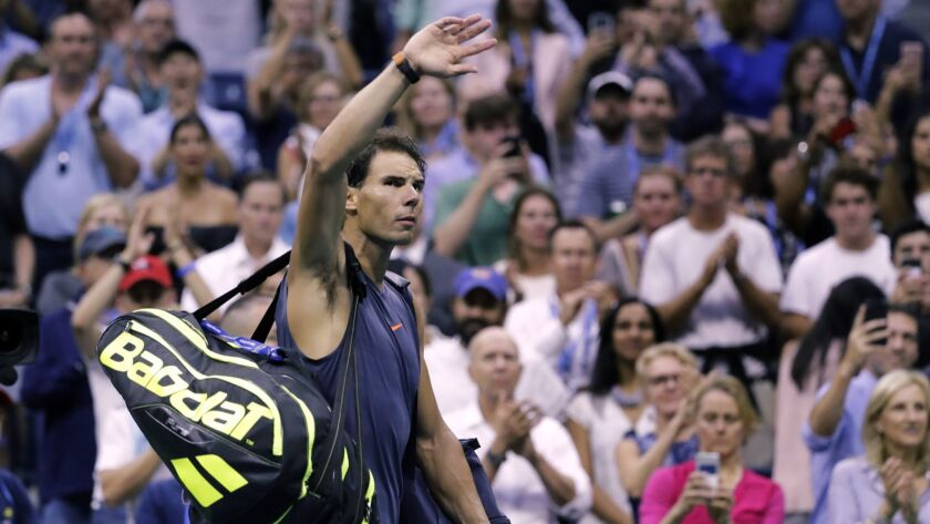 Rafael Nadal, of Spain, waves to fans after retiring from a match against Juan Martin del Potro, of