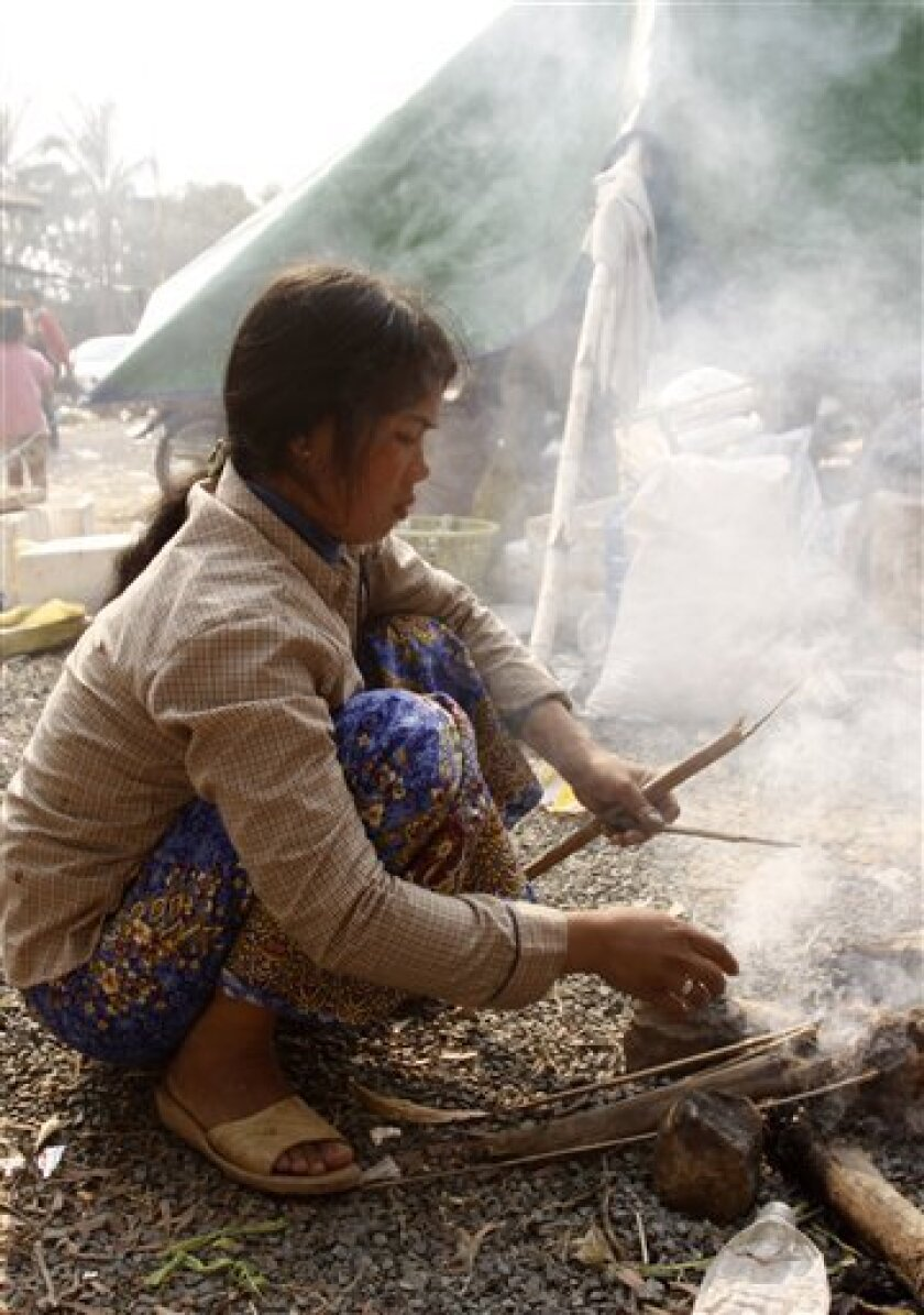 A Cambodian refugee cooks dinner at Wat Kiri Tuol Andet at a village, east of the famed Preah Vihear temple in the Cambodia-Thailand border province of Preah Vihear in Cambodia Monday, Feb. 7, 2011. Cambodia called for U.N. peacekeepers to help end the fighting along its tense border with Thailand,