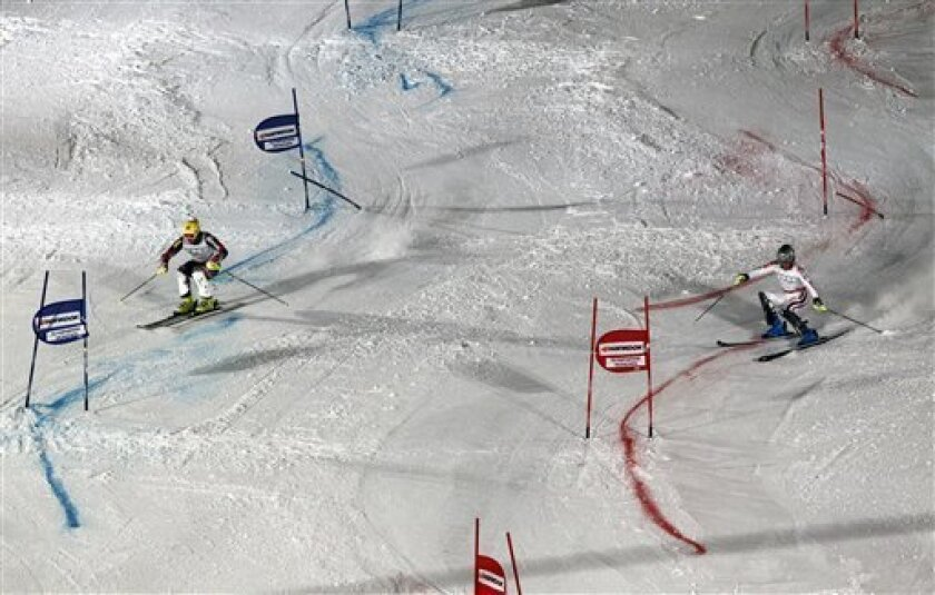 Winner Ivica Kostelic of Croataia, left, competes against second placed Julien Lizeroux of France, right, during an alpine skiing parallel slalom World Cup race held in Munich, southern Germany, on Sunday, Jan. 2, 2011. (AP Photo/dapd, Timm Schamberger)