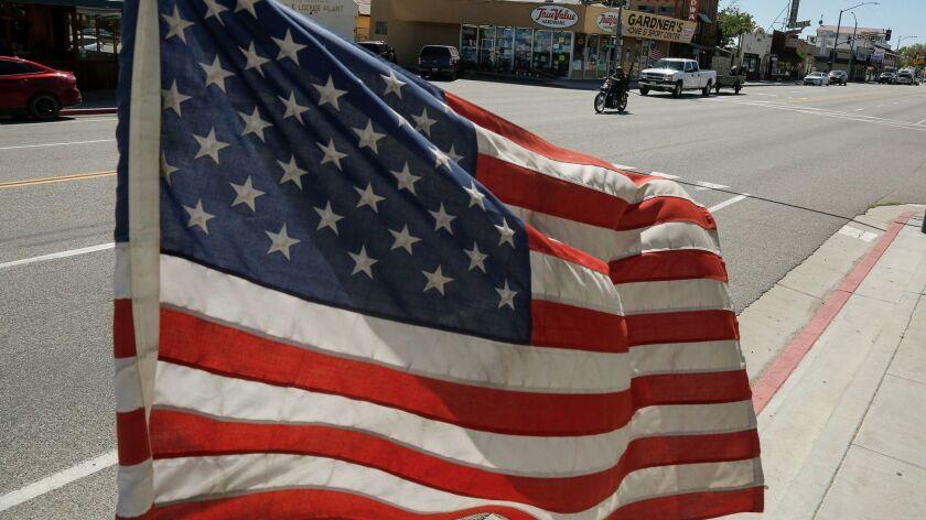 LONE PINE, CALIFORNIA, APRIL 28, 2017: American flags line the sidewalks of Lone Pine, California al
