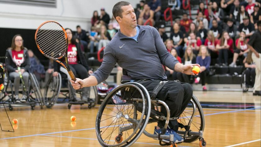 Steve Baldwin, who played in the 2016 Rio Games, starts to volley in a tennis game during the adaptive sports demonstration at SDSU's Peterson Gym on Saturday.