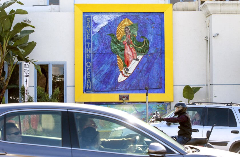 """The """"Surfing Madonna"""" mosaic displayed on Encinitas Boulevard, near the Coast Highway intersection, in Encinitas, California."""
