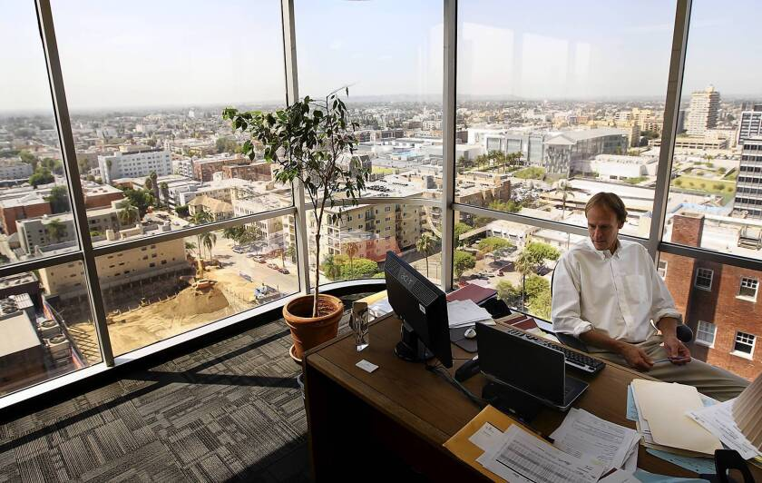 Directing Attorney Grant Specht has a nice view from his corner office at Bet Tzedek's new headquarters in Koreatown, a block from the Wilshire/Vermont Metro rail station. The building's owner gave Bet Tzedek a break on rent.