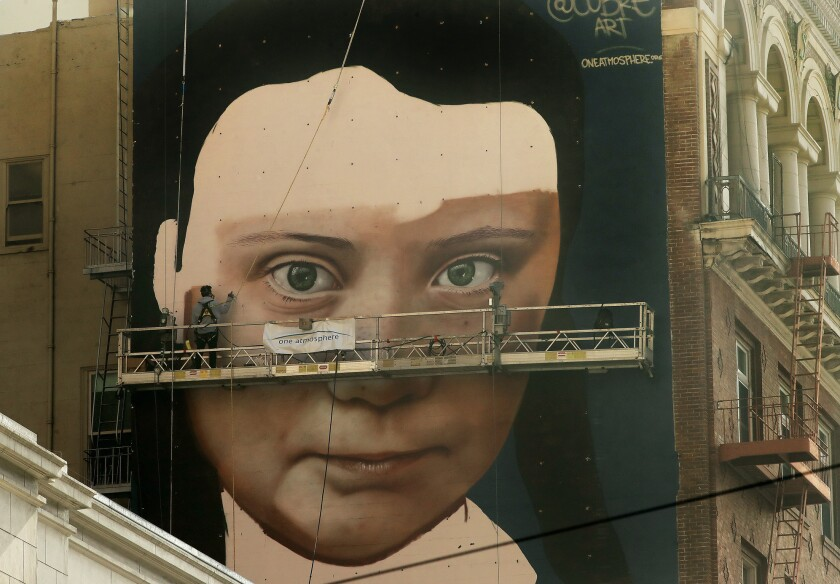 A mural was being painted on the side of a building depicting Swedish teen climate activist Greta Thunberg on Friday in San Francisco.