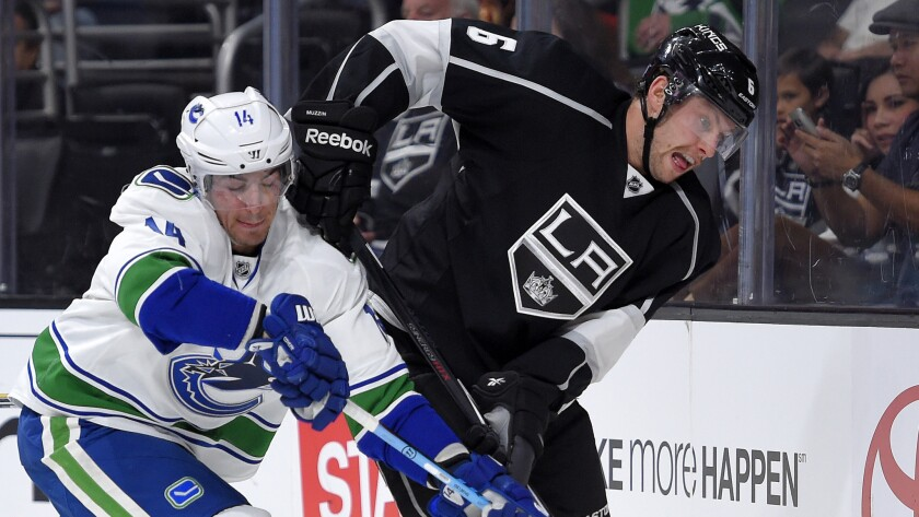 Kings defenseman Jake Muzzin battles Canucks left wing Alex Burrows during a game on Nov. 8, 2014, at Staples Center.
