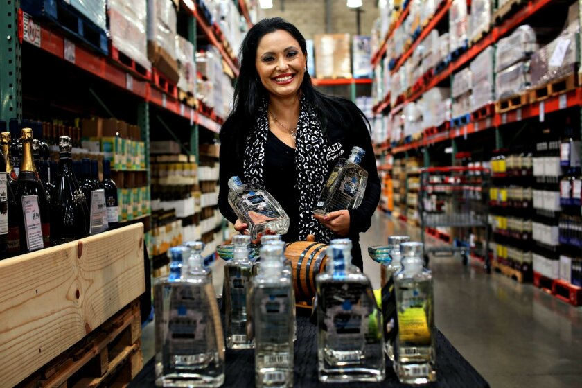 Paula Torres, founder of Nobleza Azul Tequila, stands at a display booth at Costco in Mission Valley. Nobleza is a Vista Based company
