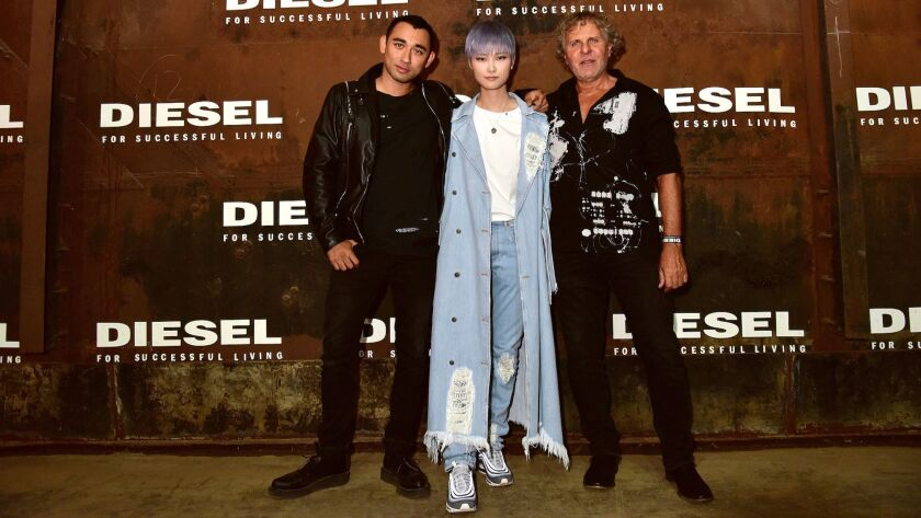 Diesel's creative director Nicola Formichetti, left, Chinese pop singer Chris Lee and Renzo Rosso, president of Diesel, have embraced the denim label's new campaign that celebrates flaws and what makes people unique.