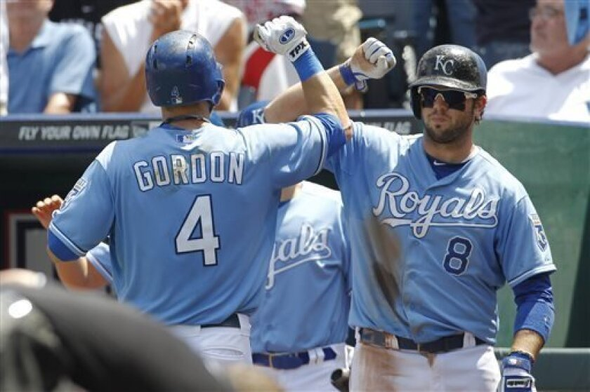Kansas City Royals' Alex Gordon (4) is congratulated by teammate Mike Moustakas (8) after hitting a home run off of Boston red sox pitcher John Lackey in the third inning of a baseball game at Kauffman Stadium in Kansas City, Mo., Sunday, Aug. 11, 2013. (AP Photo/Colin E. Braley)