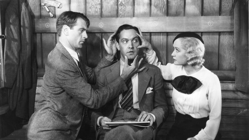 "Gary Cooper, left, Fredric March and Miriam Hopkins in ""Design for Living."""