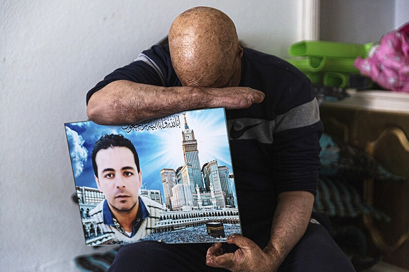 Hosni Kalaia, 49, with a photo of his younger brother, Saber, who died after setting himself ablaze in 2015.