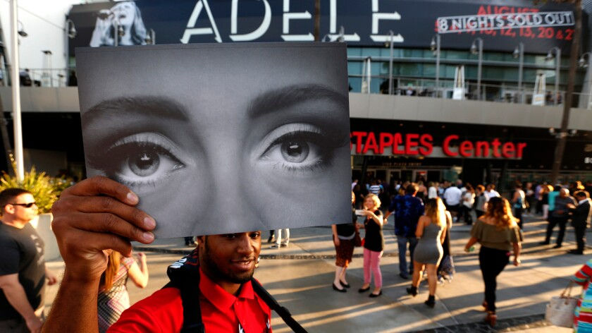 Elton Rodgers, 25, sells Adele programs on the first day of her eight night sold out run at Staples Center.