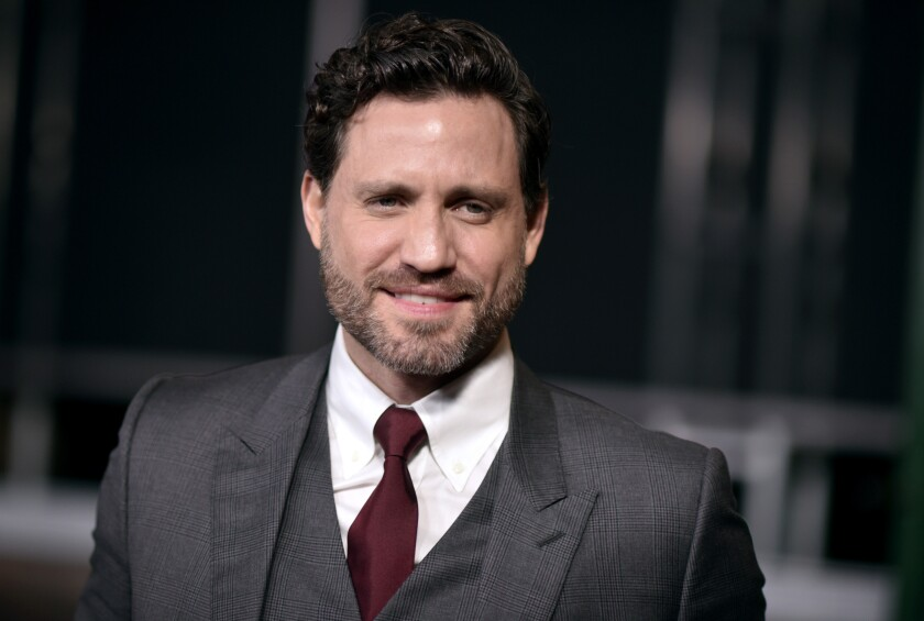 """FILE - Edgar Ramirez arrives at the Los Angeles premiere of """"The Irishman"""" on Thursday, Oct. 24, 2019, at the TCL Chinese Theatre. Ramirez wants people to understand that the fight against COVID-19 is not over. The Venezuelan actor told the Associated Press that his own family is suffering gravely. He tells the AP that he has family members who are dying of COVID-19, and that people must remain vigilant and people should """"trust science and follow the recommendations"""" and be wary of misinformation."""" (Photo by Richard Shotwell/Invision/AP, File)"""