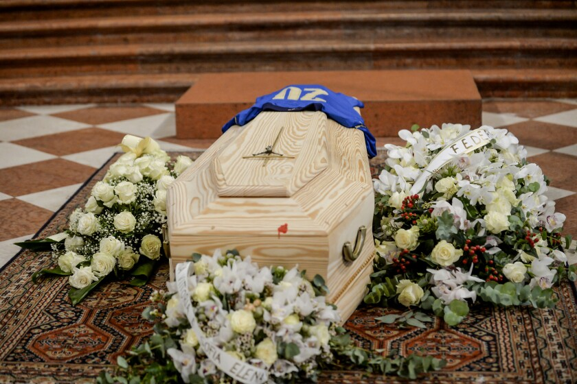 His jersey with number 20 of the winning World Cup team is placed on the coffin of Paolo Rossi during his funeral service, in Vicenza, Italy, Saturday, Dec. 12, 2020. Paolo Rossi, who led Italy to the 1982 World Cup title and later worked as a soccer commentator in his home country, died at the age of 64. (Claudio Furlan/LaPresse via AP)