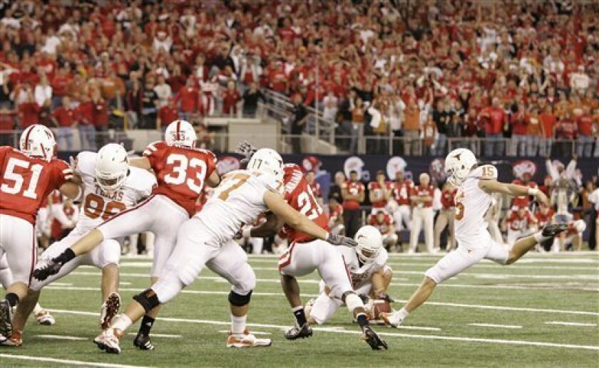 Texas kicker Hunter Lawrence (15) prepares to kick a field goal during an NCAA college football Big 12 Conference championship game against Nebraska, Saturday, Dec. 5, 2009, in Arlington, Texas. The kick was good with time expired in the 13-12 Texas win. (AP Photo/Tony Gutierrez)