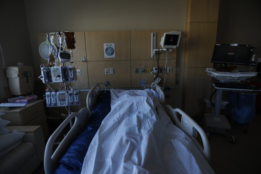 The body of a deceased COVID patient lies in a room at Providence Holy Cross Medical Center in Mission Hills.