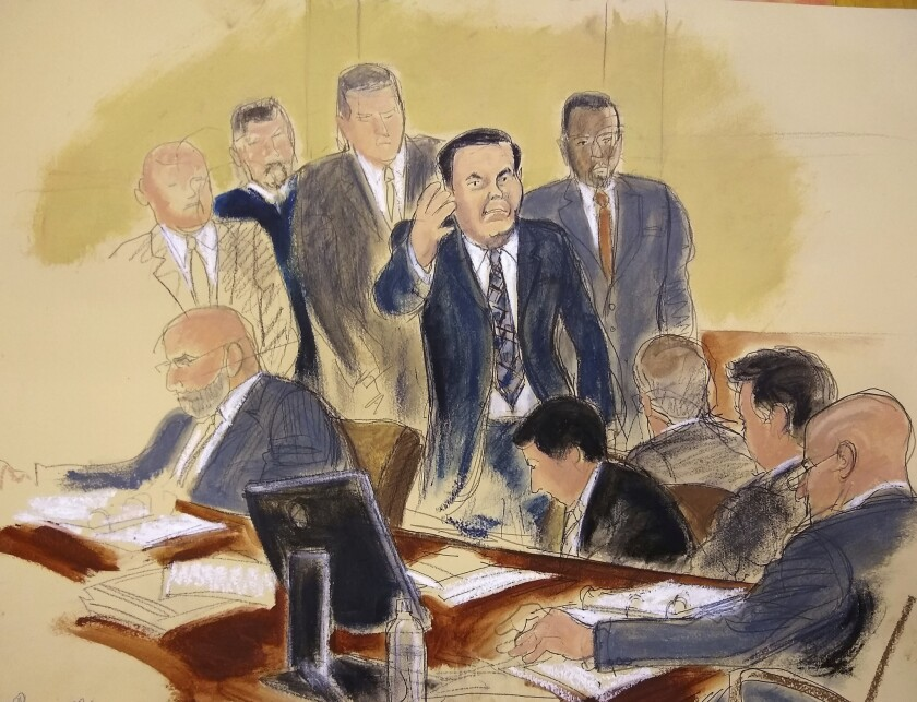 """A courtroom sketch of Joaquin """"El Chapo"""" Guzman, surrounded by U.S. Marshals, waving to his to his wife as he enters the courtroom at Brooklyn Federal Court during the start of his trial on Nov. 13, 2018. The infamous Mexican drug lord has been held in solitary confinement since his extradition to the United States early last year."""