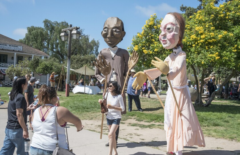 Giant puppets of famous 19th century authors will wander the park during TwainFest.